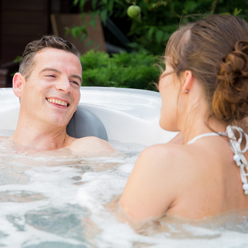enjoying the benefits of a hot tub