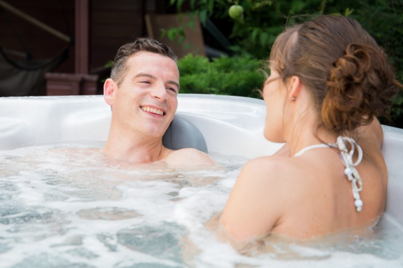 couple in the legacy hot tub