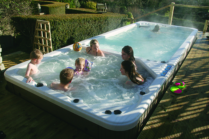 family enjoying the swim spa
